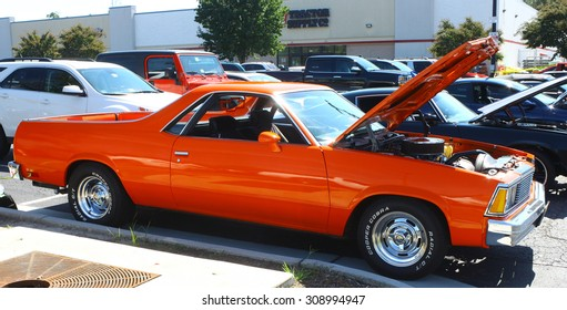 GLOUCESTER, VIRGINIA - AUGUST 22, 2015:An orange Chevrolet ElCamino in the DRIVE-IN FOR DIABETES CAR SHOW Sponsored by Tractor Supply in August in Gloucester Virginia.