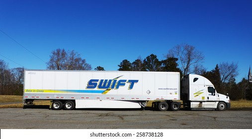 GLOUCESTER, VIRGINIA - JANUARY 28, 2015: A Swift delivery truck Parked to the side of the road, Swift is North America's Largest Full Truckload Carrier, Swift Transportation began operations in 1966.