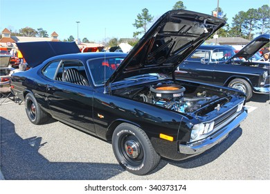 GLOUCESTER, VIRGINIA - NOVEMBER 14, 2015: A black Dodge Dart Demon in the annual Shop With  a Cop Car Show held once each year to help benefit needy children of Gloucester for Christmas.
