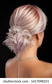 Glour coiffure on beautiful woman with blond hair. Hair accessories. Modern hairstyle.