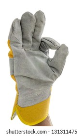 Gloved hand of a construction worker showing an Ok sign. Isolated over white background.