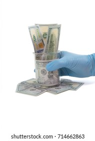 Gloved hand grabs beaker stuffed with money