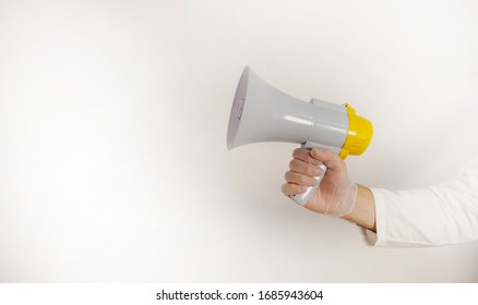 gloved hands using megaphone, with copy space