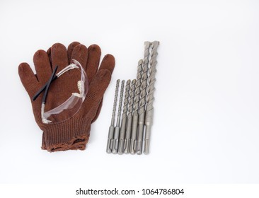 Gloves, glasses and drills for concrete isolated on white