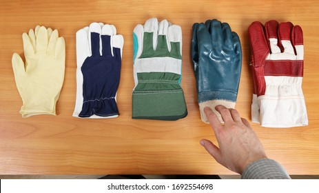 Gloves are laid out on the table and have different degrees of protection. A person decides which ones to choose to perform a specific task