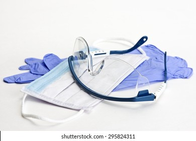 Gloves, mask and safety glasses for personal protection during medical procedures.