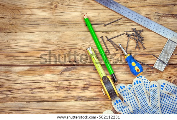 gloves and tools on wooden table