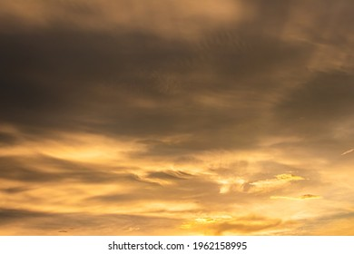 glow dramatic colorful rain cloud sky sunset with twilight color golden sky and clouds. Gradient color. Sky texture abstract nature background.