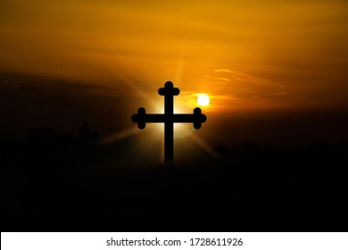 Glow of the Lord. Holy place. The concept of Jesus Christ: the cross at sunset.