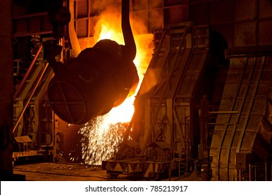Glow and Sparks produced while pouring of raw metal into  hot furnace by large ladle of Steel plant