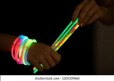 glow sticks with hands