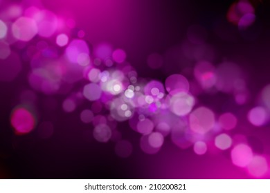 Glowing abstract defocused lights black and purple background