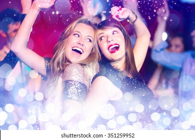 Glowing background against happy friends having fun together