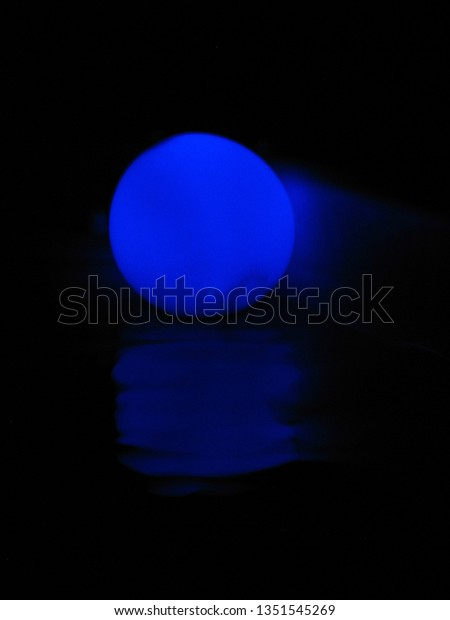 glowing blue balloon at night with blue ripple