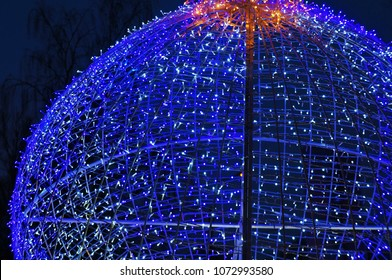 Glowing blue garland in the shape of a ball