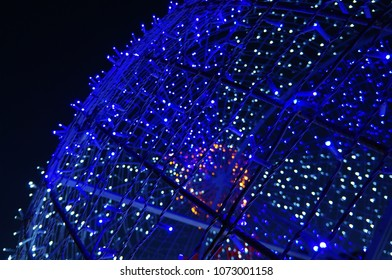 Glowing blue garland in the shape of a ball close up