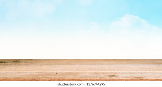 glowing blue sky and clouds panoramic background with sunny flare light with modern wood panel perspective:advertising product on display
