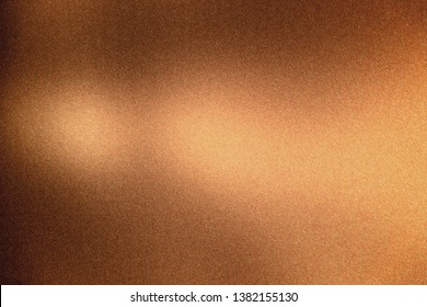 Glowing bronze rough metal wall, abstract texture background