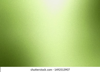 Glowing brushed green metallic wall surface, abstract texture background