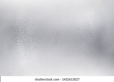 Glowing brushed silver foil metallic wall, abstract texture background