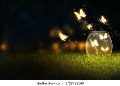 Glowing bug firefly, butterfly coming out of a jar in a night isolated on a natural background. Magic night imagination. Magical nature concept. Artistic design raster illustration manipulation
