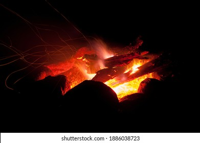 Glowing campfire keeping you warm while camping