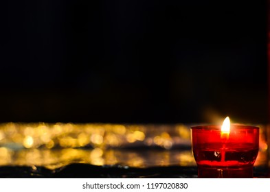 Glowing candle at night