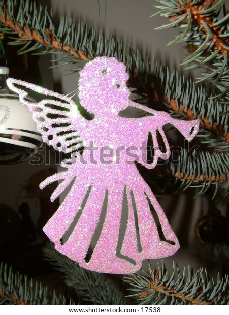 glowing christmas tree angel playing flute