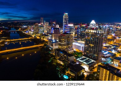 Glowing city at night an amazing glowing nightscape over bridges and buildings of Austin Texas skyline cityscape mirrored reflection of the amazing perfect capital city of Texas