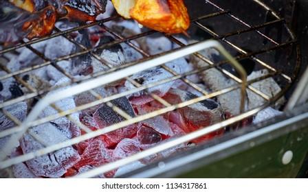 Glowing coal underneath grill