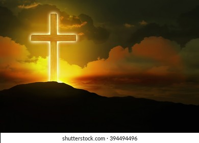 Glowing cross up to the hill