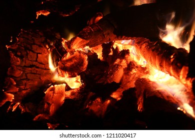 Glowing embers from burning wood