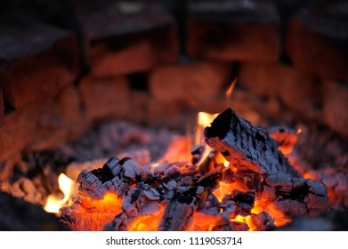 Glowing embers in fireplace
