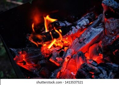 Glowing embers in hot red color, abstract background. The hot embers of burning wood log fire. Firewood burning on grill. Texture fire bonfire embers!!