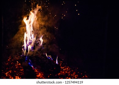 A glowing fire in the stone fireplace