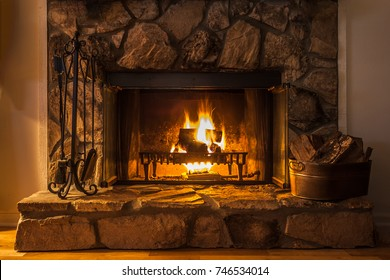A glowing fire in the stone fireplace to warm a chilly night.