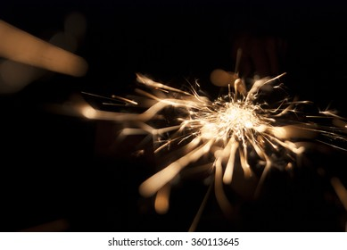 Glowing Flow of sparks in the Dark in motion. Sparkling stars dust trail (light effect)