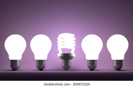 Glowing fluorescent light bulb in row of incandescent ones on violet textured background