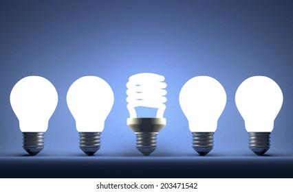 Glowing fluorescent light bulb in row of incandescent ones on blue textured background