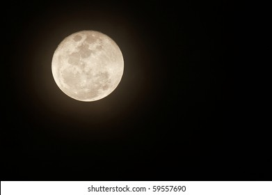 Glowing full moon with plenty of space for text