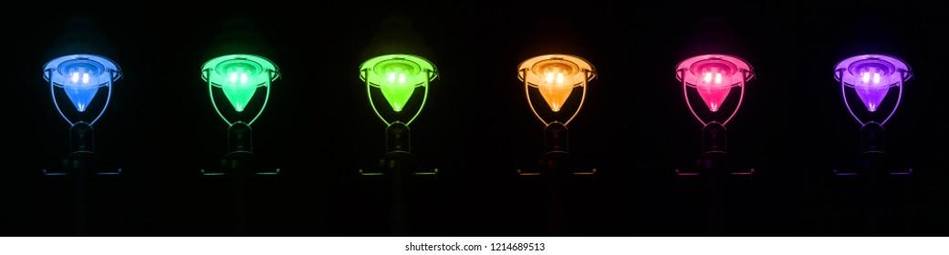 Glowing gas lantern on the roadside at night.