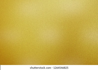 Glowing golden paint steel sheet texture, abstract pattern background