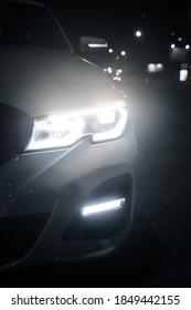 Glowing Headlight of a modern car close-up