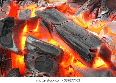 Glowing Hot Charcoal In BBQ Grill Pit With Flames Background Texture, Close-up