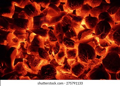 Glowing Hot Charcoal Briquettes Close-up Background Texture