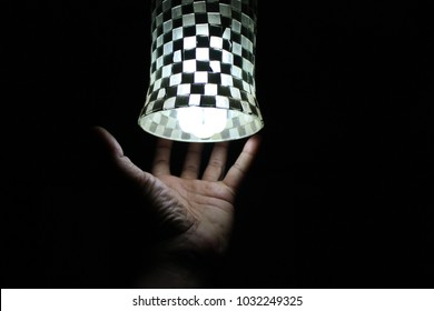 Glowing Led light lamp hanging over dark background