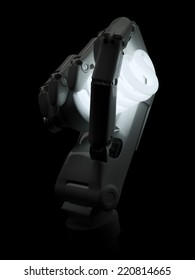 Glowing light bulb in robot hand isolated on black