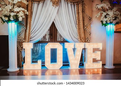 Glowing love text. 3d letters wedding dance floor decoration. Light bulb shiny banner.