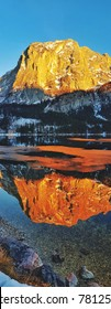 Glowing Mountain in Austria with reflection in lake