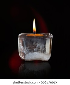 Glowing mourning candle.